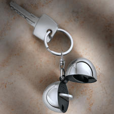 Design-Schlüsselanhänger Coin - Alessi-Design hält Ihre Schlüssel. Und bewahrt den Einkaufschip. Aus hochglanzpoliertem Edelstahl.