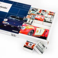 Umgedreht fügen sich die 24Boxen zu einem neuen Porsche-Motiv zusammen.
