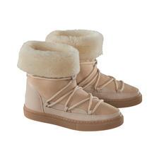 Inuikii Lammfell-Slimline-Boots - 100 % modisch. 100 % wintertauglich. Die Lammfellboots von Inuikii.