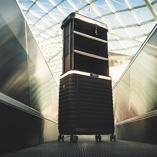 PULL UP Suitcase® 2-in-1 Patentierte 2-in-1-Konstruktion transportiert und verwahrt Ihre Reisegarderobe geordnet und mit einem Griff zur Hand.