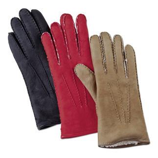 Der Luxus-Handschuh aus seltenem Curly-Lammpelz. Handgefertigt von Merola/ Italien. Feines Veloursleder. Perfekte Passform. Besonders dicht, leicht und wärmend: das Haar neuseeländischer Lämmer.