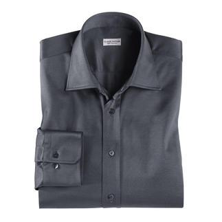 Das Jersey-Hemd von Claude Dufour. Korrekt genug für offizielle Termine. Aber bequem wie ein Freizeit-Shirt. Veredelte Baumwolle: geschmeidig glatt, seidig glänzend und dauerhaft farbbrillant.