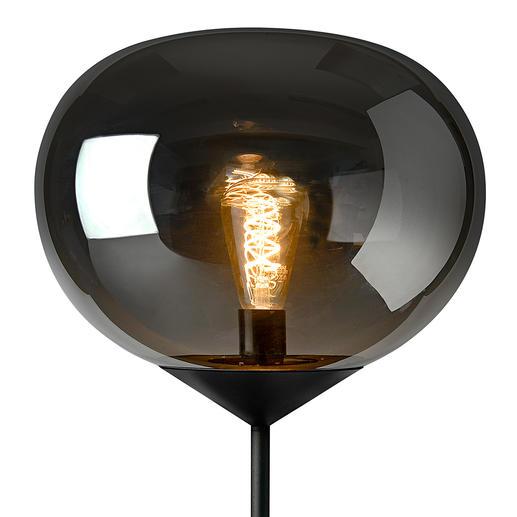 Schalten Sie das Licht an – und wie von magischer Hand wird die Glaskuppel transparent und bringt die leuchtende Glühbirne zum Vorschein.