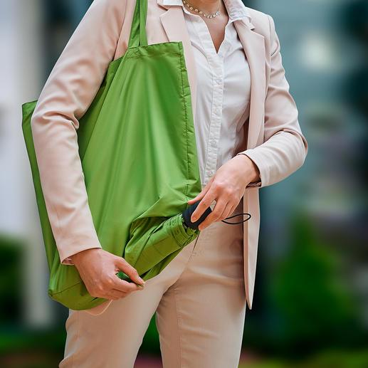 Nachhaltiger Taschenschirm Genial: Taschenschirm und Einkaufstasche in einem.