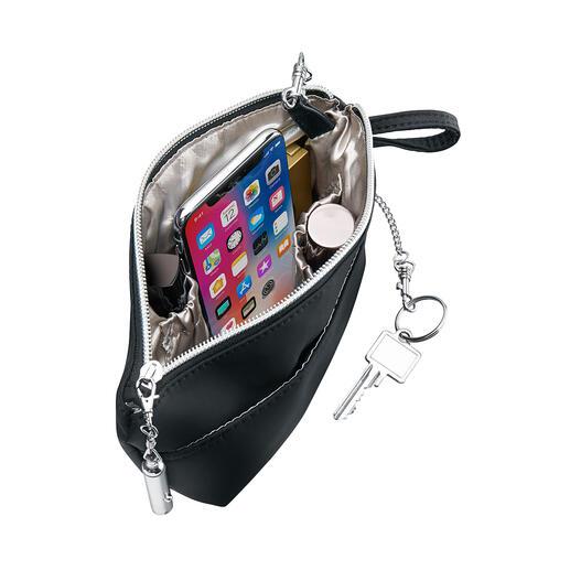 Mit Bag'nBag wechseln Ihre Utensilien auf einen Griff Ihre Handtasche.
