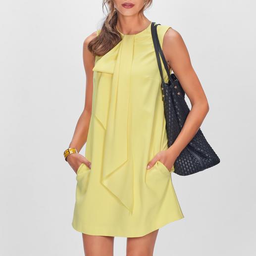 Bewährt in Schnitt und Material. Neu in dem modischen Farb-Highlight Gelb. Das Couture-Kleid von Paule Ka.